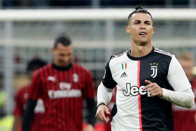 Juventus' Cristiano Ronaldo celebrates after scoring with penalty against AC Milan during an Italian...