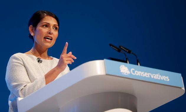 Britain's Home Secretary Priti Patel addresses the delegates at the Conservative Party Conference in...
