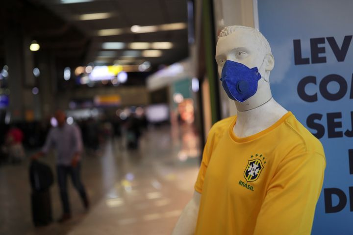 A mannequin wearing a protective mask and Brazil's soccer jersey.