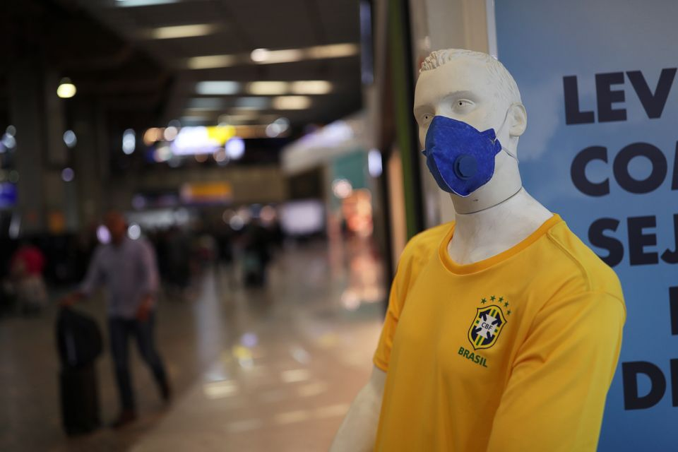 A mannequin wearing a protective mask and Brazil's soccer