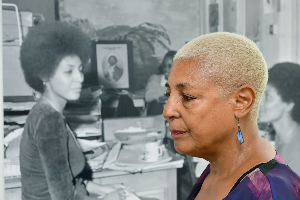 Leila Howe Hussan seen with a photo of her taken by Neil Kenlock at Expectations: The Untold Story of...