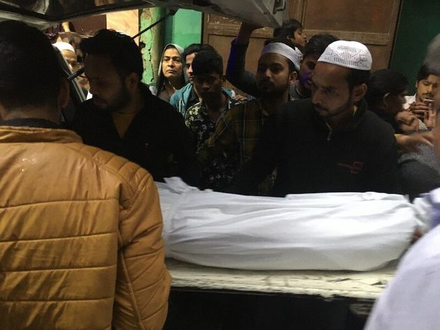 Faizan's family members receive his body at his home in Kardampuri on 29