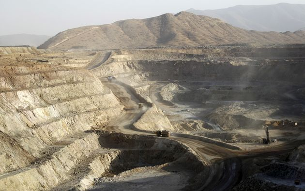 Trucks ferry excavated gold, copper and zinc ore from the main mining pit at the Bisha Mining Share Company...