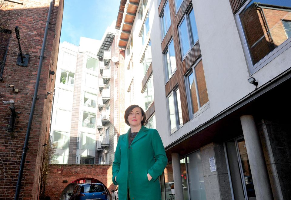Rachael Loftus outside her apartment block in Leeds which has to pay for round-the-clock patrols or face...
