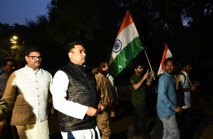 BJP leader Kapil Mishra takes part in a march to pay tribute to IB officer Ankit Sharma and Delhi Police constable Rattan Lal on February 27, 2020 in New Delhi.