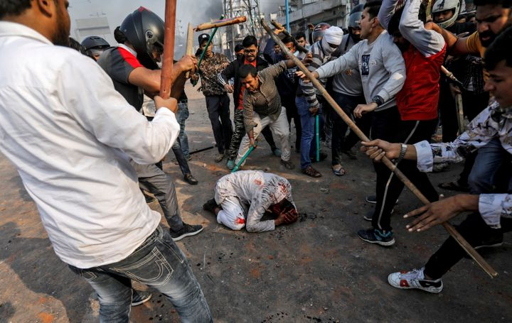 """A group of men chanting pro-Hindu slogans beat Mohammad Zubair, 37, during protests sparked by a new citizenship law in New Delhi on Feb. 24, 2020. """"What kind of humanity is this?"""" asked the Muslim man."""