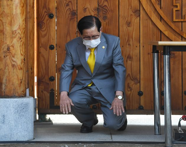 Lee Man-hee, leader of the Shincheonji Church of Jesus, bows during a press conference at a facility...