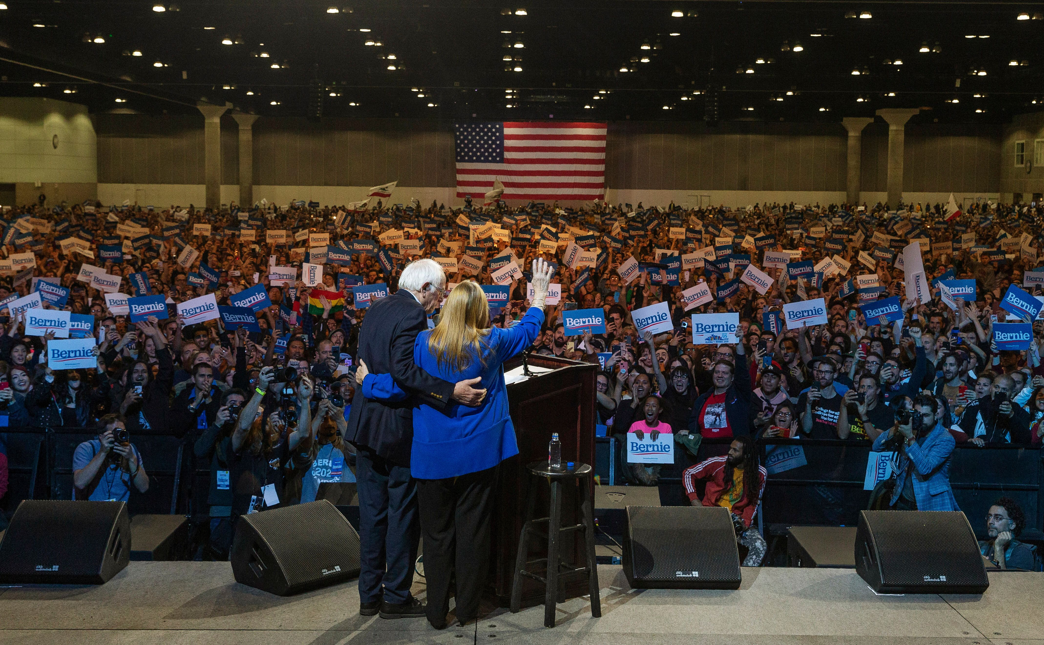 Jane Sanders and Sen. Bernie Sanders (I-Vt.) wave at supporters in Los Angeles on March 1, 2020.A sweeping victory in California would give Sanders a massive advantage that will be hard for his rivals to catch up to.