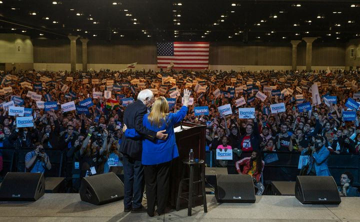 U.S. Sen. Bernie Sanders holds his wife, Jane, as they wave at supporters in Los Angeles on March 1.A sweeping victory in California would give Sanders a massive advantage that will be hard for his rivals to match.