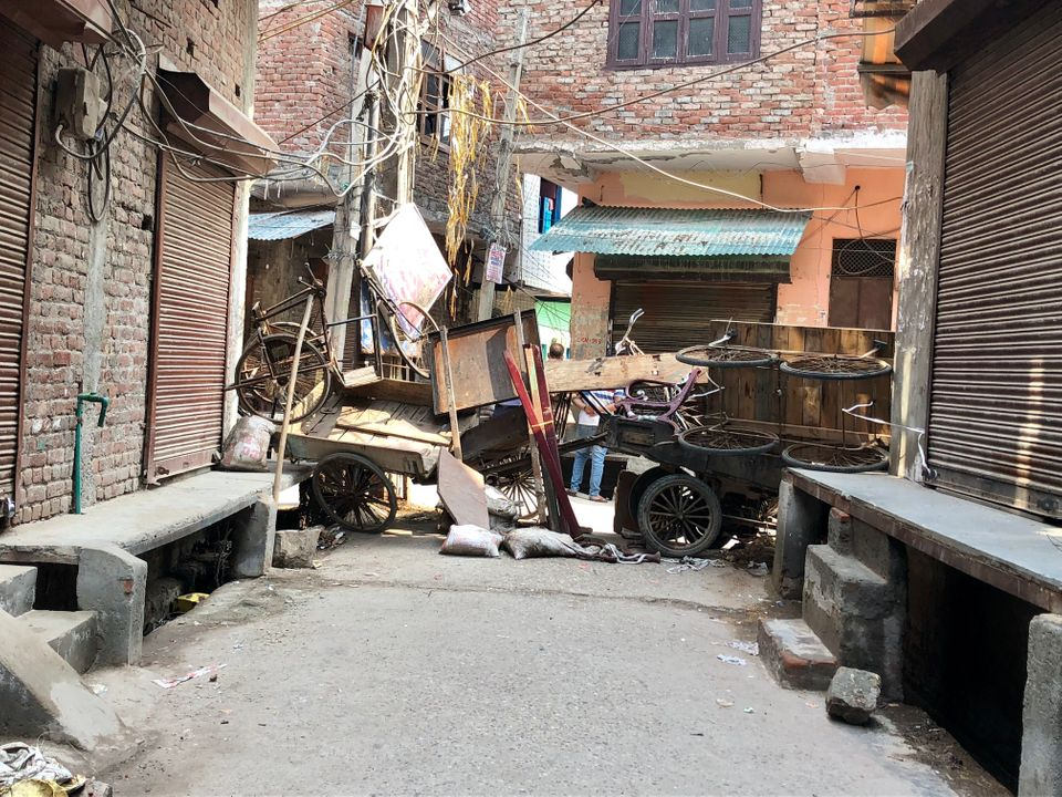 Barricades made of carts, furniture and bamboo sticks were still mounted a week after the worst rioting...