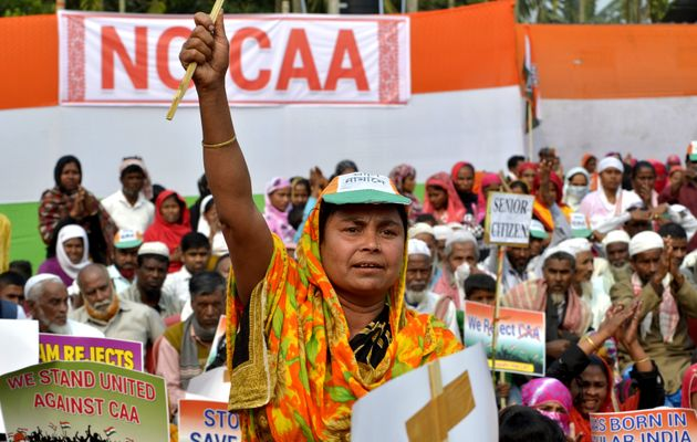 Women participate in a rally to protest the Citizenship Amendment Act (CAA) at Rupahi in Nawgaon, Assam,...