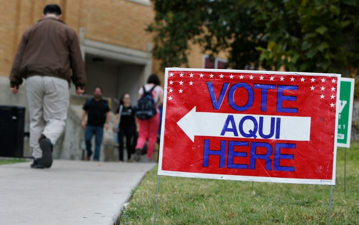 A sign shows the way to the polling station at Austin Community College on Nov. 4, 2014 in Austin, Texas. Voters headed to th