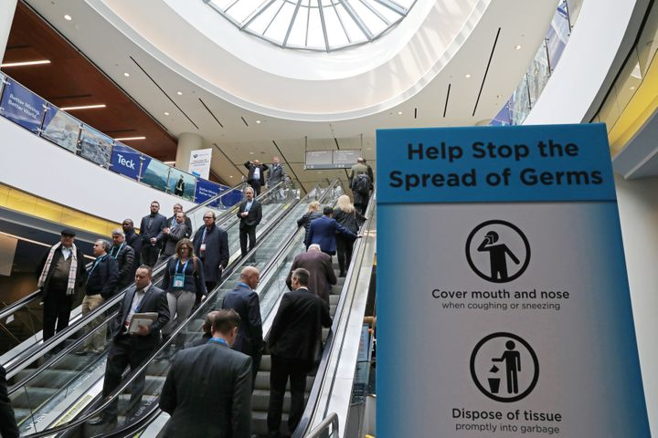 A sign warning about the spread of germs is shown at a conference in Toronto on Mar. 1, 2020.