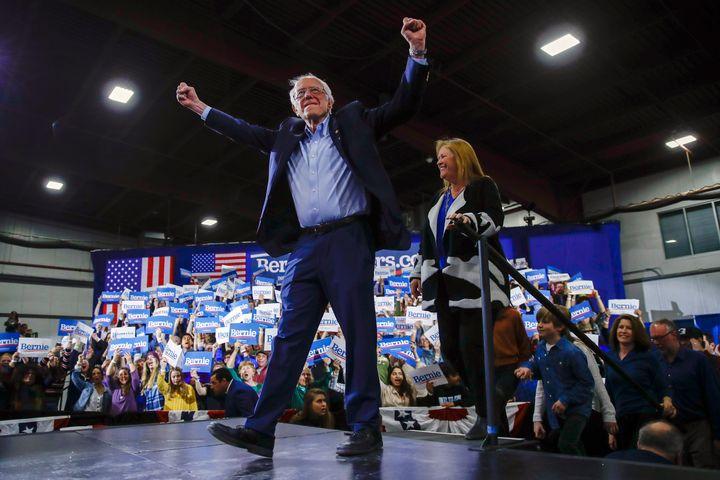Democratic presidential candidate Sen. Bernie Sanders (I-Vt.), accompanied by his wife, Jane O'Meara Sanders, speaks during a