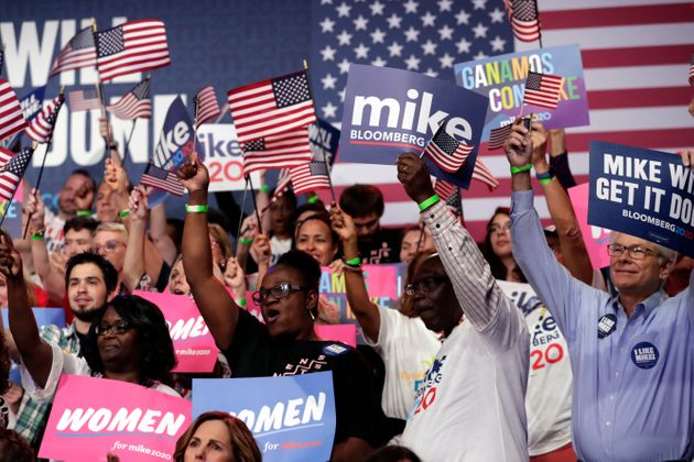 Supporters of Democratic presidential candidate Mike Bloomberg attend a primary election night campaign...