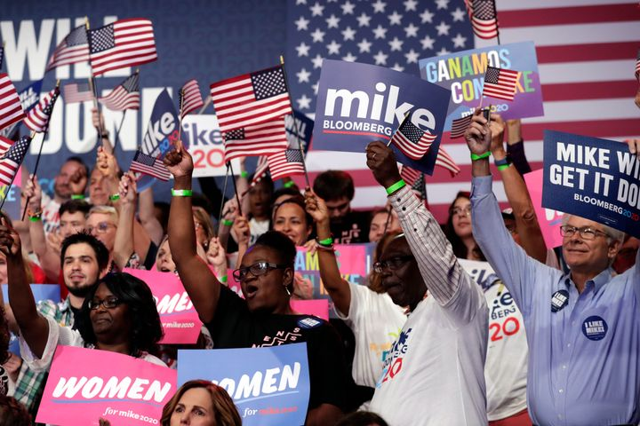 Supporters of Democratic presidential candidate Mike Bloomberg attend a primary election night campaign rally Tuesday in West