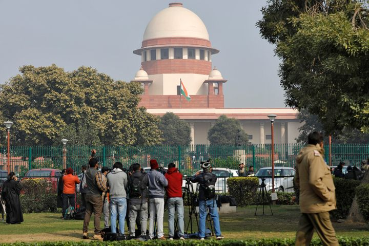 Television journalists are seen outside the premises of the Supreme Court in New Delhi.