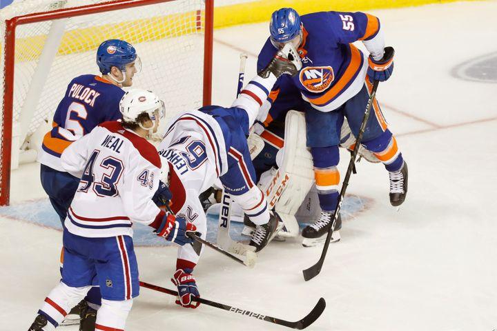 New York Islanders defenseman Johnny Boychuk (55) takes a skate to the face as Montreal Canadiens left wing Artturi Lehkonen