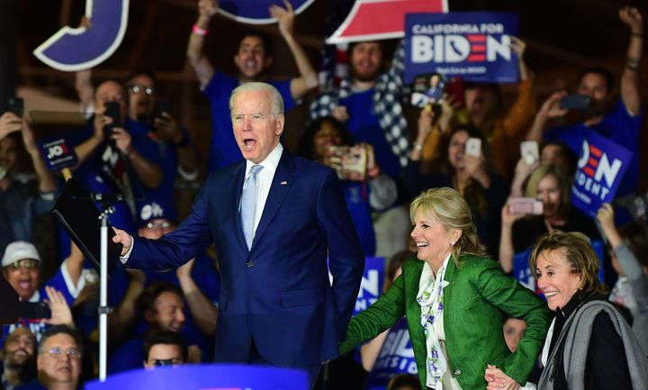 Former U.S. vice-president Joe Biden attends a campaign event in Los Angeles on Tuesday with his wife, Jill Biden, to his right.