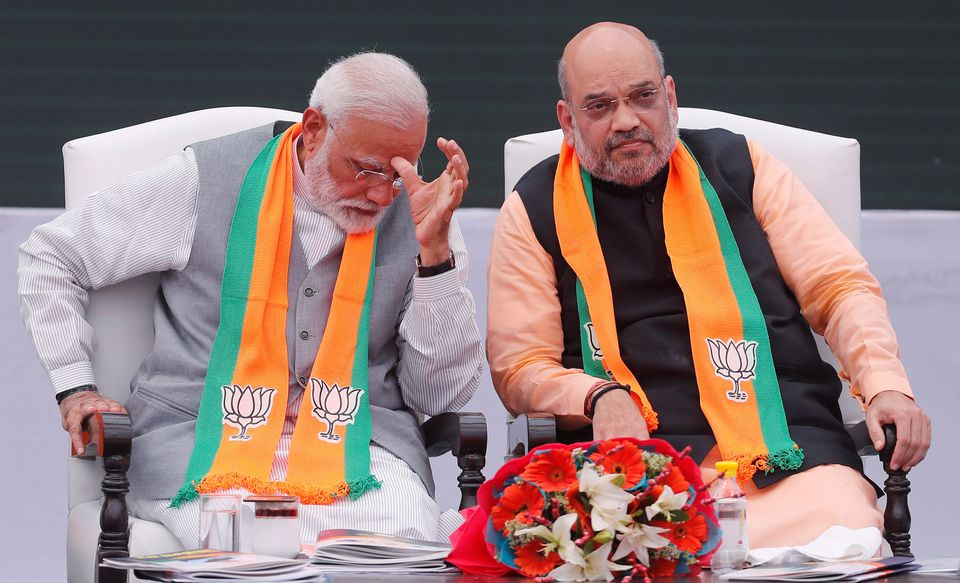 Prime Minister Narendra Modi (left) gestures as Home Minister Amit Shah looks on in this file