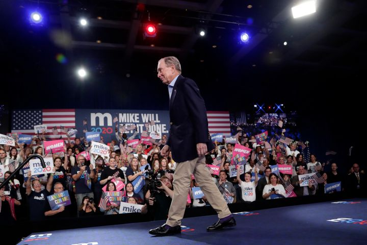 Former New York City Mayor Mike Bloomberg walks off stage after speaking during a rally Tuesday in West Palm Beach, Florida.