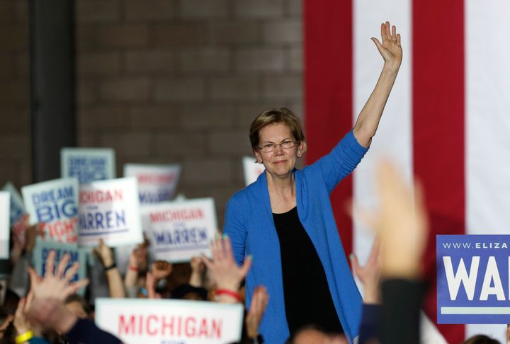 Sen. Elizabeth Warren (D-Mass.) waves to supporters at her Super Tuesday rally in Detroit.