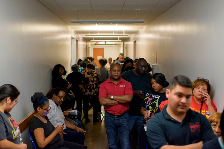 Voters line up at a polling station during the presidential primary in Houston on March 3, 2020.