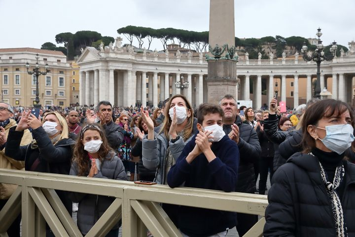 Pilgrims arrive in St. Peter's Square at the Vatican wearing masks to protect themselves from COVID-19 on March 1.