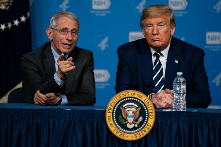President Donald Trump listens to Dr. Anthony Fauci, director of the National Institute of Allergy and Infectious Diseases, d