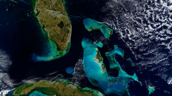 A satellite image of Florida (top left), the Bahamas (right) and Cuba (bottom left).