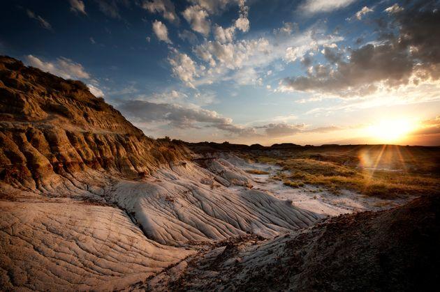 The sun sets over Dinosaur Provincial Park near Drumheller,