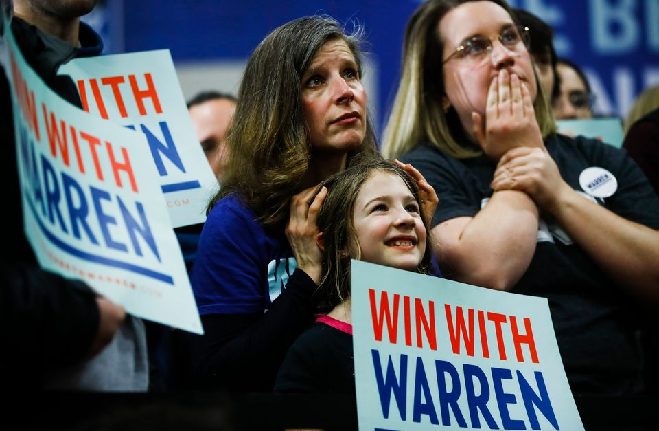 Attendees listened to Warren speak during a Feb. 9 campaign event at Rundlett Middle School in Concord,...