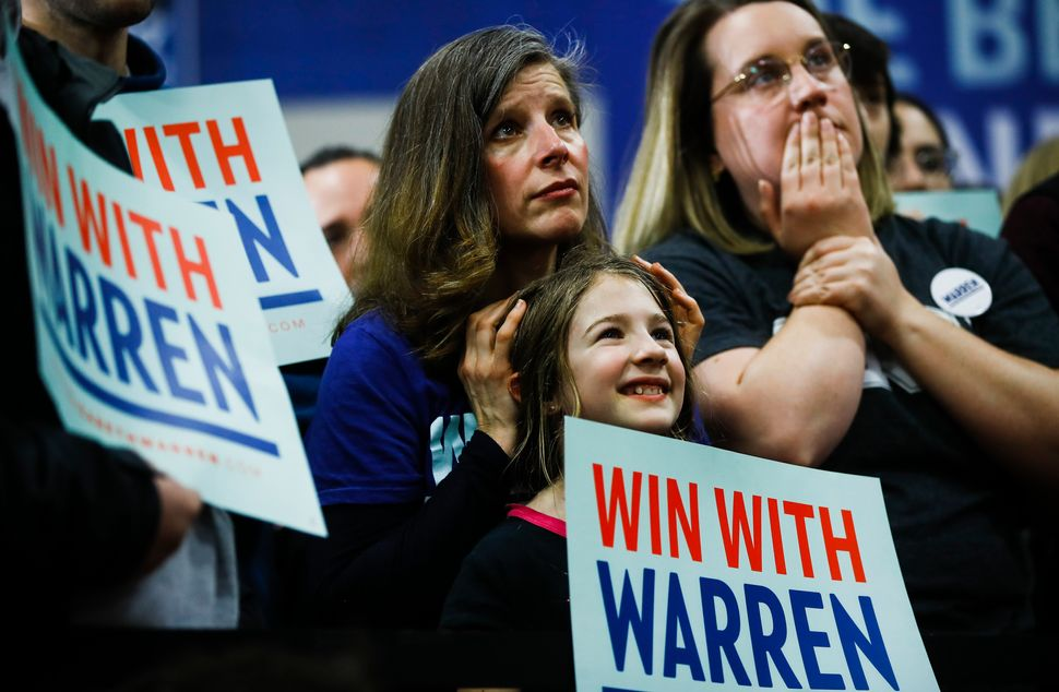 Attendees listened to Warren speak during a Feb. 9 campaign event at Rundlett Middle School in Concord, New Hampshire.