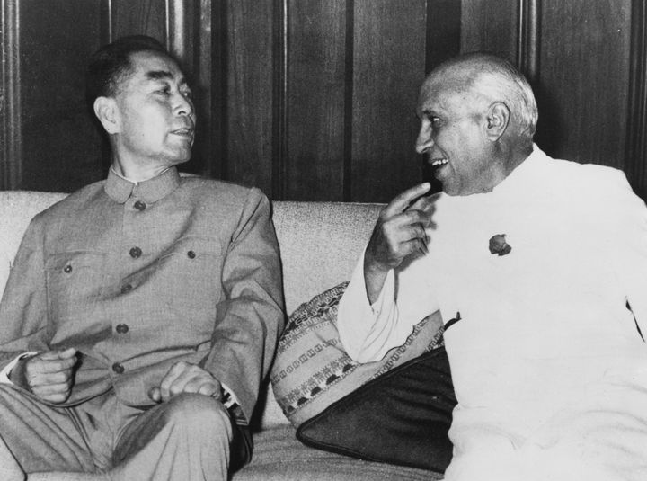 Zhou Enlai, then Premier of the People's Republic of China, with then Indian Prime Minister Jawaharlal Nehru during a visit to India, 21st April 1960.