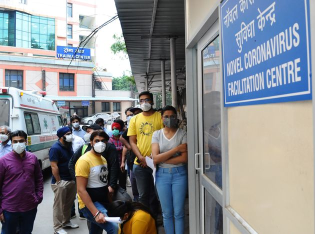 People People queue up at a COVID screening center at Ram Manohar Lohia Hospital