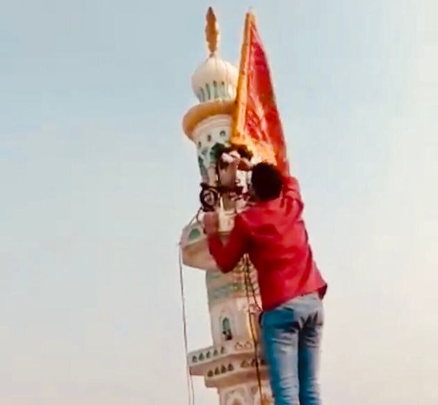 Ravi Parashar, a Delhi resident, took down the saffron flag that Hindu rioters had hoisted atop a mosque...