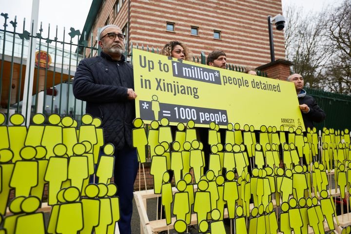 Human rights activists display dolls which they say depicts thousands of missing ethnic Uighurs outside the Chinese embassy o
