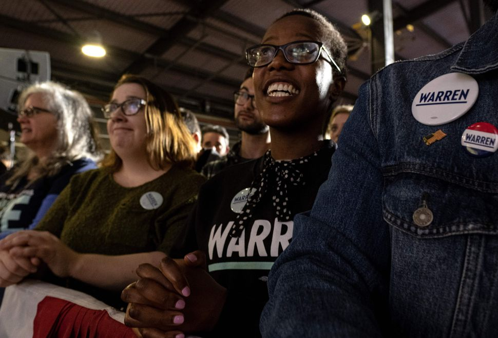 Supporters of Democratic Presidential hopeful Massachusetts Senator Elizabeth Warren attend a rally March 3, 2020 in Detroit,