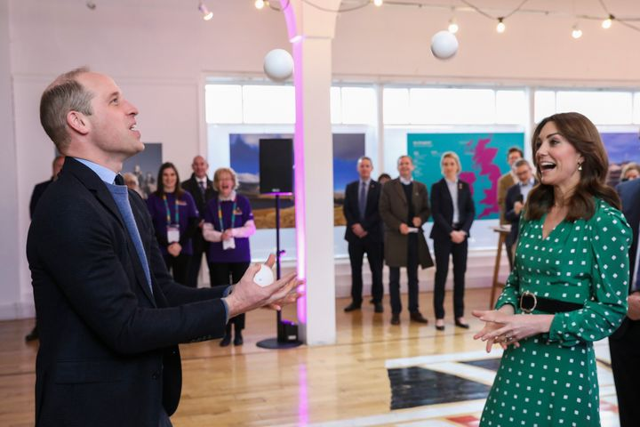 The Duke of Cambridge juggles during a meeting with Galway Community Circus performers, local artists and young musicians on