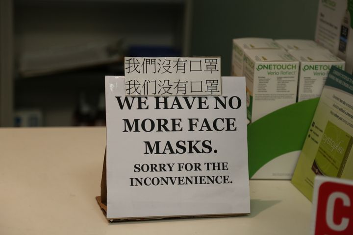 A sign at a pharmacy is seen here in Vancouver on Jan. 28.Pharmacists are already seeing heightened demand for over-the-counter items like masks and hand sanitizers.