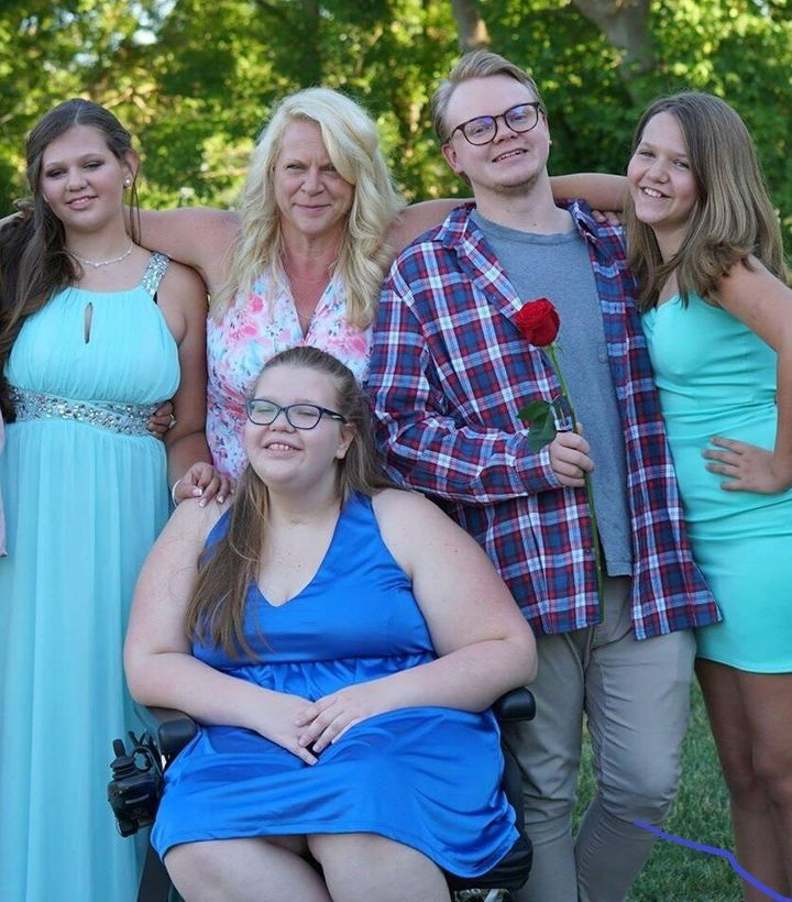Christine (second to the left), Emma (centre), and her siblings all have varying degrees of mitochondrial disease. Emma and her brother deal with the most severe symptoms. Her mother, as a carrier, experiences fatigue.