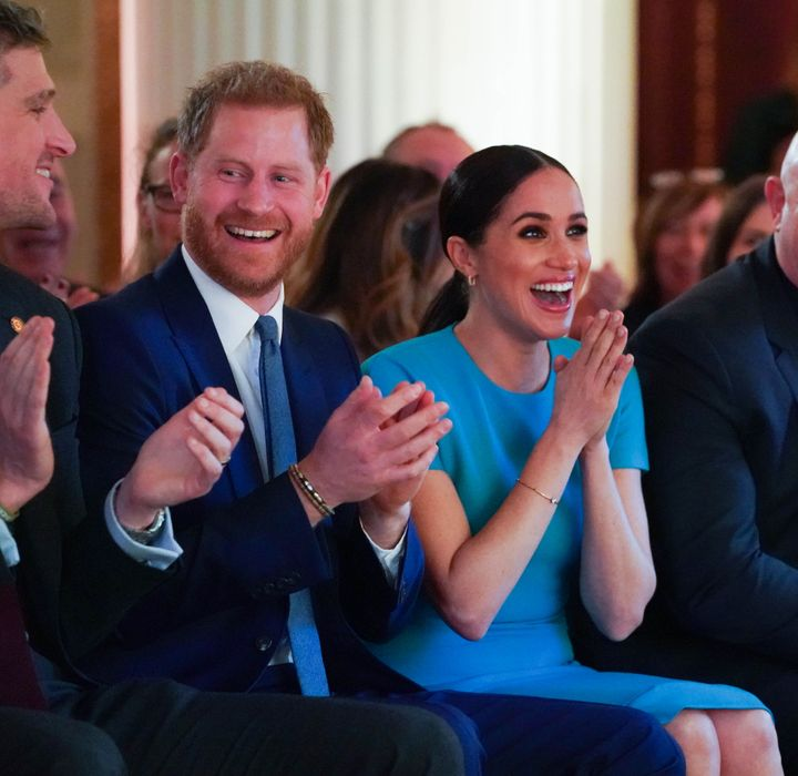 Harry and Meghan reacting to the proposal.