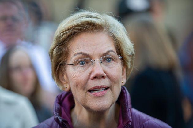 Democratic presidential candidate Massachusetts Senator Elizabeth Warren announces the suspension of...