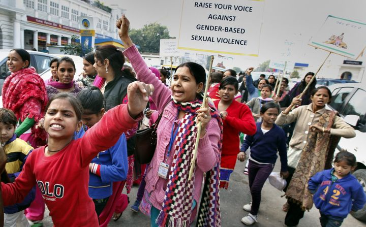 Girls and women raising slogans during a march organised by the Apne Aap Women Worldwide NGO in memory of the 2012 gang-rape victim on the eve of the anniversary of the attack, at Connaught Place on December 15, 2014 in New Delhi.