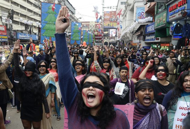 Women wear blindfolds during a demonstration to protest against violence against women in Kolkata, January...