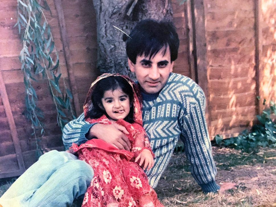 A young Sharan with her father