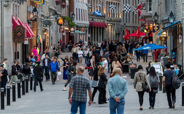 In this stock photo, pedestrians walk along Saint Paul Street in Old Montreal. The province of Quebec...