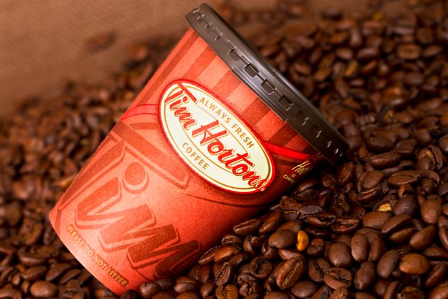 In this 2011 file photo, a Tim Hortons take-out coffee cup is pictured lying on the