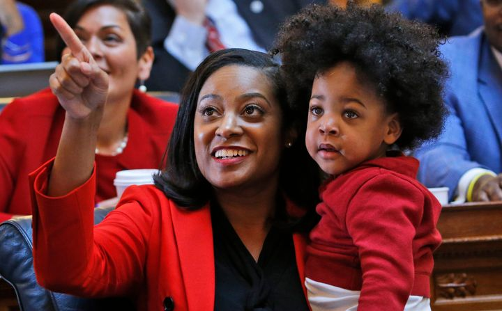 Virginia state Del. Jennifer Carroll Foy (D), holding her son, is running for governor.