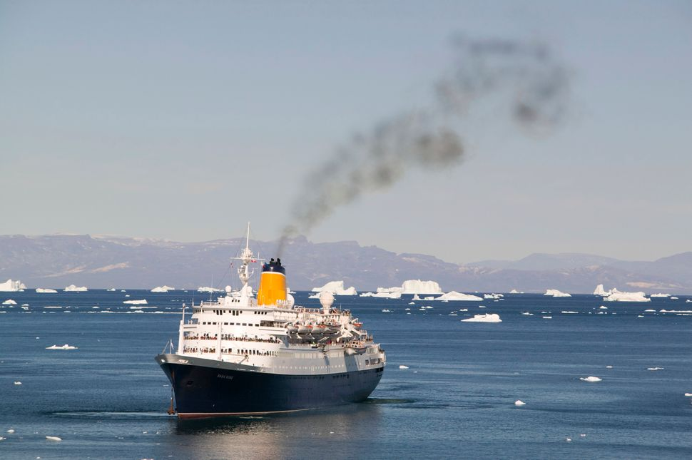 A cruise ship off Ilulissat on Greenland, which is a UNESCO World Heritage Site because of the Jacobshavn Glacier or Sermeq K